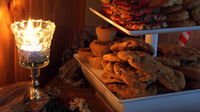Christmas cookies and candle. Closeup of freshly cooked Christmas cookies illuminated by candle light Royalty Free Stock Photos