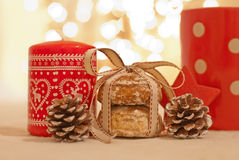 Christmas. Cookies, candle and pine cone Stock Photo