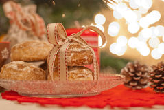 Christmas. Cookies, candle and pine cone Royalty Free Stock Photo