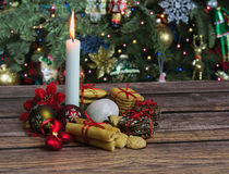 Christmas cookies and candle on wooden table Royalty Free Stock Photos