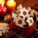 Christmas cookies. Candles and decorations stock photos