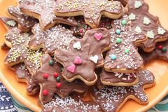 Christmas cookies with chocolate. Some christmas cookies with chocolate and sprinkles of sugar stock images