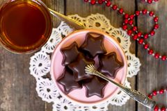 Christmas cookies - chocolate stars and cup of tea royalty free stock photography
