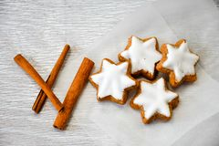 Christmas cookies. Cinnamon on vintage wood background - dark moody of decorative food, simple composition royalty free stock photo