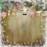 Christmas cookies, Christmas decorations, pine branches on a snowy wooden background. Wooden background with Christmas cookies, pine branches and Christmas vector illustration