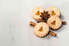 Christmas cookies with christmas tree, cinnamon and anise. Christmas cookies with christmas tree, cinnamon sticks and anise star on white wooden background Stock Photography