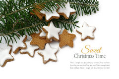 Christmas cookies, cinnamon stars with fir branches on white bac Stock Images