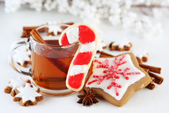 Christmas cookies. With cinnamon sticks and a cup of tea Stock Images