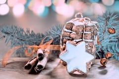 Christmas cookies, cinnamon sticks and festive lights, tinted ma Royalty Free Stock Images