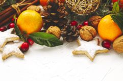 Christmas cookies, citrus, decoration and gifts stock image