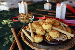 Christmas cookies with coconut on a decorated table with lighted candles Stock Image