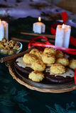 Christmas cookies with coconut on a decorated table with lighted candles Royalty Free Stock Photo