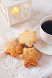 Christmas cookies, coffee and  burning lantern Royalty Free Stock Images