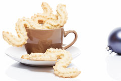 Christmas cookies in a coffee cup Royalty Free Stock Photos