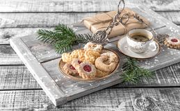 Christmas cookies coffee decorations wooden background. Christmas cookies with coffee and decorations on rustic wooden background Stock Photo