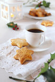 Christmas cookies, coffee, holly and  burning lantern Royalty Free Stock Images