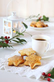 Christmas cookies, coffee, holly and  burning lantern Stock Photography