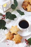Christmas cookies, coffee, holly and  burning lantern Royalty Free Stock Photo