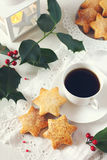 Christmas cookies, coffee, holly and  burning lantern Royalty Free Stock Image