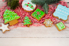 Christmas cookies. Colorful mix of ginger cookies on a light wood background Stock Images