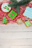 Christmas cookies. Colorful mix of ginger cookies on a light wood background Stock Photos