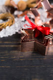 Christmas cookies - copper star-shaped cookies cutters on white Royalty Free Stock Images