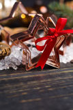 Christmas cookies - copper star-shaped cookies cutters on white Stock Photography