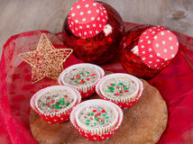 Christmas cookies and cream cheesecakes in muffin forms Royalty Free Stock Photography