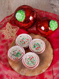 Christmas cookies and cream cheesecakes in muffin forms Stock Photos