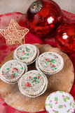 Christmas cookies and cream cheesecakes in muffin forms Stock Photo