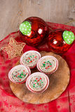 Christmas cookies and cream cheesecakes in muffin forms Royalty Free Stock Photo