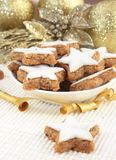 Christmas cookies on a cream and gold background Royalty Free Stock Photo