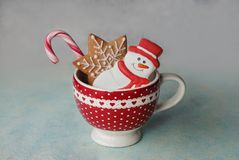 Christmas cookies in cup. Christmas cookies in the red cup, New year decor stock image