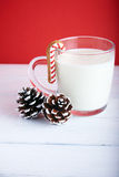 Christmas cookies with cup of milk at a red background Stock Photo