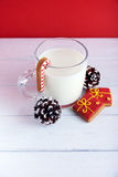 Christmas cookies with cup of milk at a red background Stock Photography