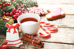 Christmas cookies with cup of tea. On a brown wooden table stock photo