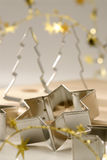 Christmas cookies cutters. Tree and star shapes. Royalty Free Stock Photography