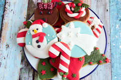 Christmas cookies. Decorated Christmas cookies on the plate royalty free stock photography