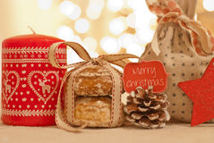 Christmas. Cookies decorated with ribbon, candle and pine cone Royalty Free Stock Photography