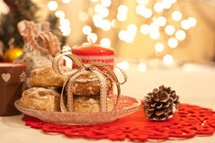 Christmas. Cookies decorated with ribbon, candle and pine cone Stock Image