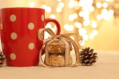 Christmas. Cookies decorated with ribbon, cup and pine cone Stock Photos