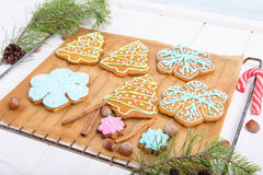 Christmas cookies, decorated sugar and gingerbread in tree and snowflake shapes. Royalty Free Stock Photos