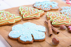Christmas cookies, decorated sugar and gingerbread in tree and snowflake shapes. Royalty Free Stock Photo