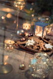 Christmas cookies on decorated table with candles Stock Photography