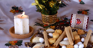 Christmas cookies decorated on a table with lighted candle Stock Photo