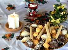 Christmas cookies decorated on a table with lighted candle Royalty Free Stock Photography