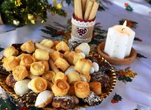 Christmas cookies decorated on a table with lighted candle Stock Image