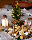 Christmas cookies decorated on a table with lighted candle Stock Images