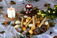 Christmas cookies decorated on a table with lighted candle Stock Photos