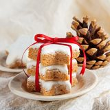 Christmas cookies decorated on wooden background with napkin. And red ribbon, German Zimtsterne Stock Image